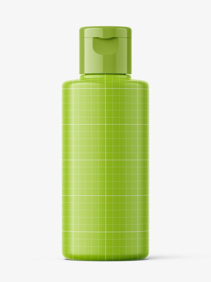 Transparent bottle with flip top mockup / 100 ml