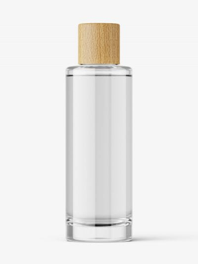 Clear cosmetic bottle with wooden cap